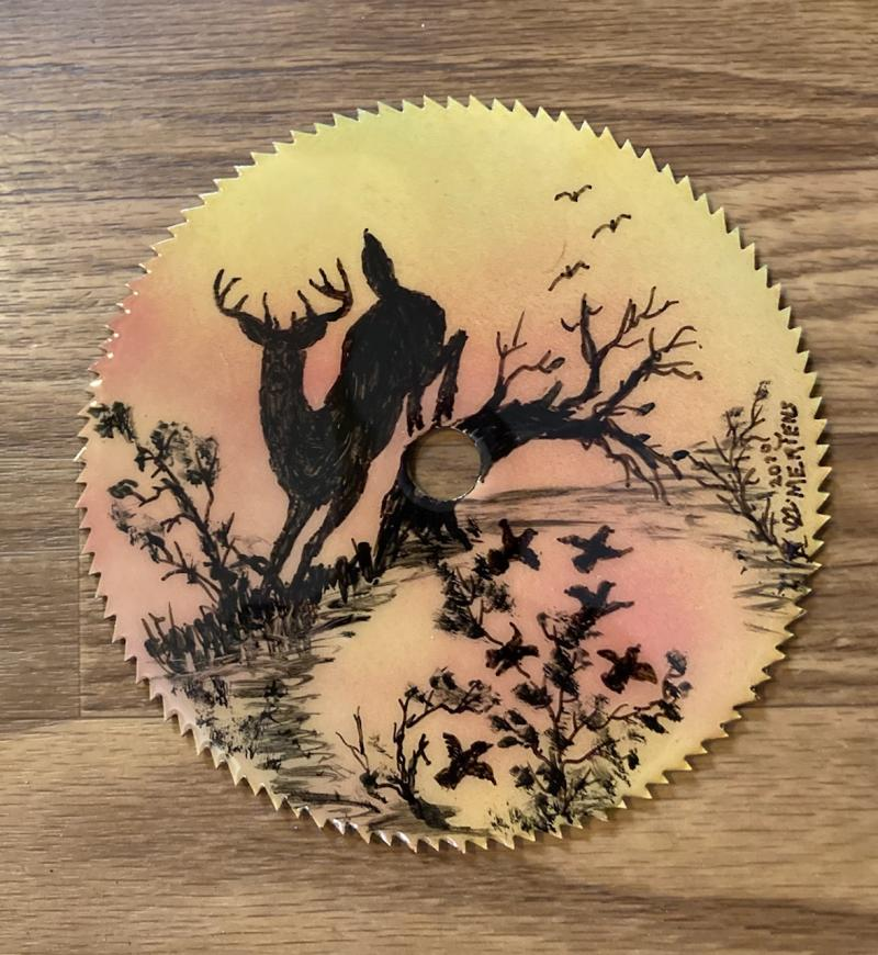 Hand painted round sawblade with jumping deer mertensfrontierranch.com